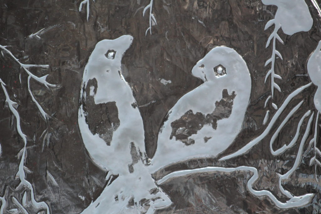Carving of two birds on an ice sculpture