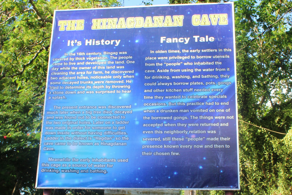 Sign with the history of Hinagdanan Cave